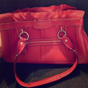 New, red leather Coach purse 3 compartments zipper